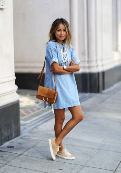 light blue and white mini shift jean dress with brown suede shoulder bag