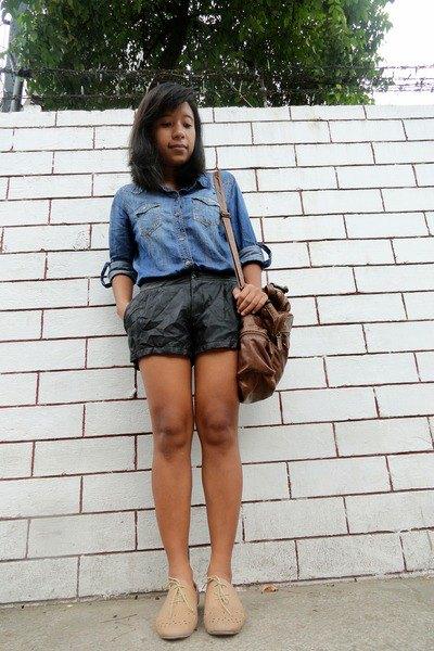 light blue chambray shirt with black mini shorts