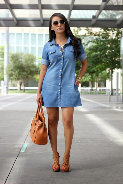 light blue jean dress with brown leather handbag