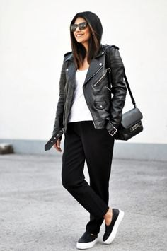 moto jacket with slim fit jeans and black leather sneakers