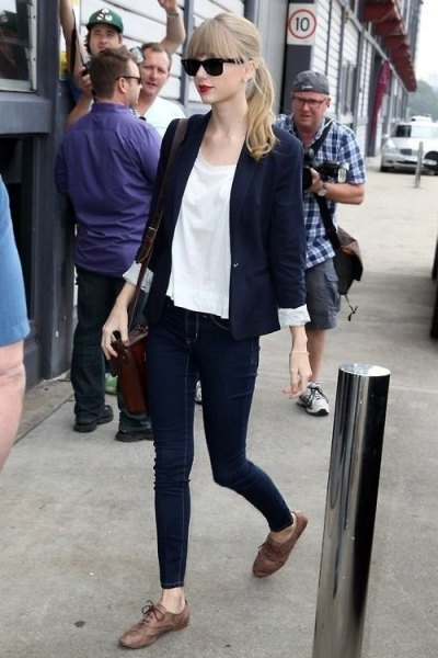 navy blue blazer with white chiffon blouse and grey oxford dress shoes
