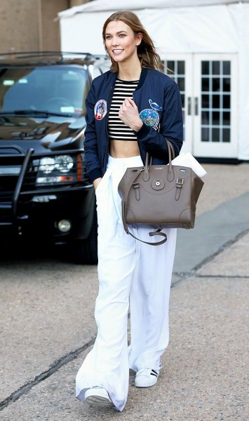 navy blue cropped bomber jacket with white wide leg pants
