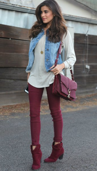 pale pink long sleeve tee with light blue denim vest and burgundy short boots