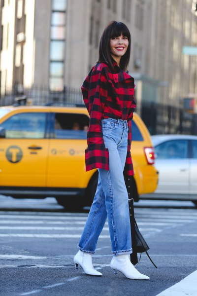 red and black plaid shirt with blue straight cut jeans and white kitten heel boots
