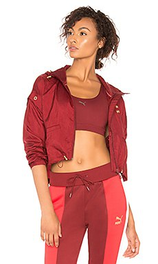 red mini bomber jacket with crop top and running pants