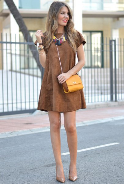short sleeve swing brown dress with mustard shoulder purse