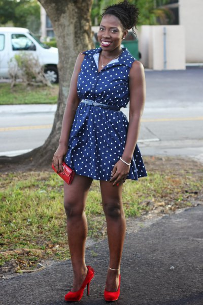 sleeveless blue polka dot belted mini shirt dress with red heels