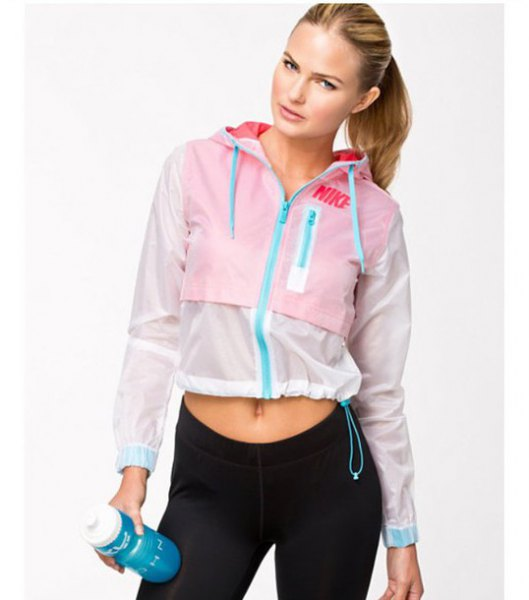 white and baby blue cropped running jacket with black jogging tights