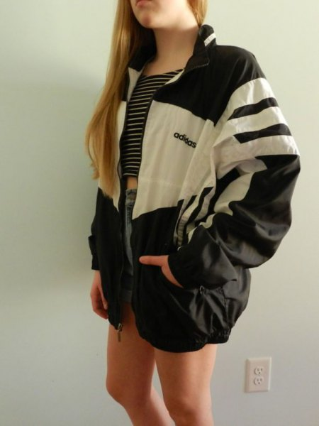 white and black color block oversized windbreaker with blue denim mini shorts