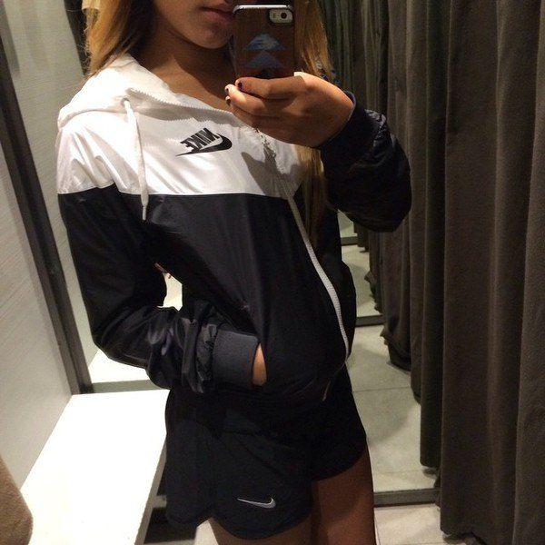 white and black windbreaker with mini running shorts