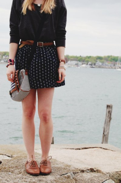 white blouse with mini printed belted skater skirt and brown leather shoes