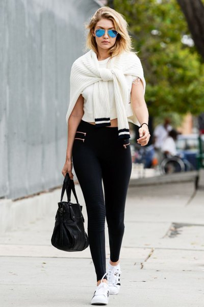 white cropped tee with ribbed knit cardigan and black high rise leggings