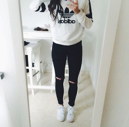 white graphic adidas sweatshirt with ripped leggings
