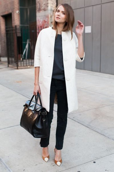 white long wool coat with black chinos and red cap toe heels