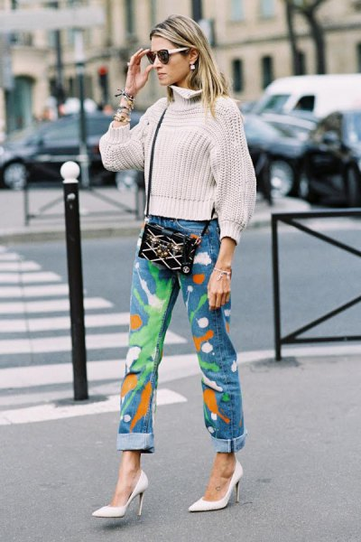 white mock neck ribbed cropped sweater with blue high rise paint splatter jeans