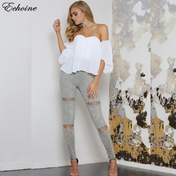 white off the shoulder chiffon blouse with grey skinny jeans