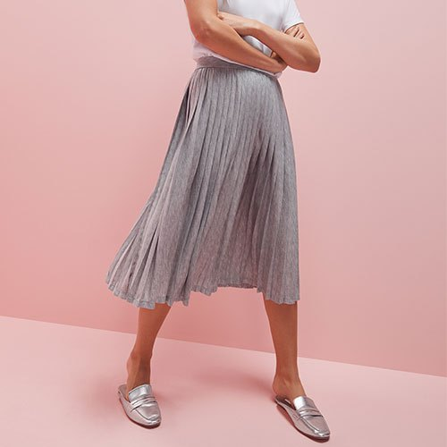 white t shirt with light grey pleated midi skirt and silver dress shoes