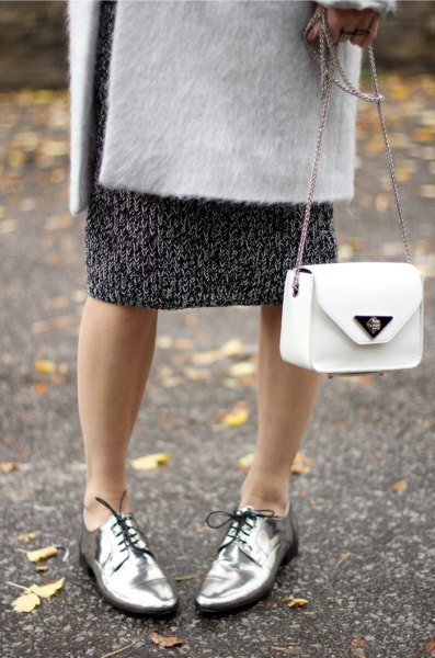 white wool coat with black printed midi shift dress and silver dress shoes