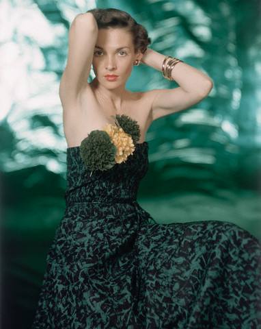 Model in Strapless Green Dress with Silk Flowers