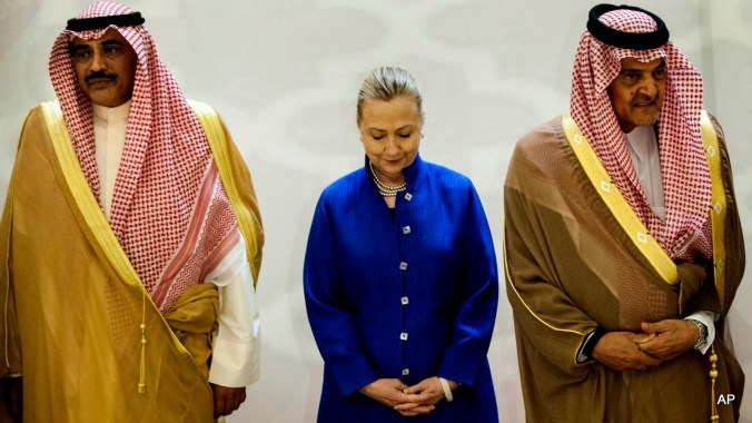 Saudi Foreign Minister Prince Saud Al-Faisal, right, U.S. Secretary of State Hillary Clinton, center, and Kuwaiti Foreign Minister Sheikh Sabah Khaled al-Hamad Al-Sabah, left, stand together prior to a group photo before a US- Gulf Cooperation Council forum at the Gulf Cooperation Council Secretariat in Riyadh, Saudi Arabia, Saturday, March 31, 2012. Secretary Clinton is visiting the region to speak with leaders about local and global issues including Iran as well as attend talks aimed at ending the violence by the Assad regime towards its citizens in Syria.(AP Photo/Brendan Smialowski, Pool)