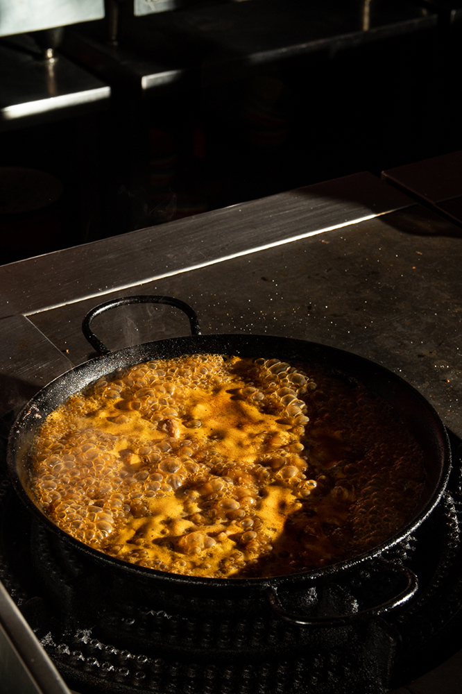 With an open kitchen, the Tomatito kitchen team can show off their skills in making this Paella de Mole