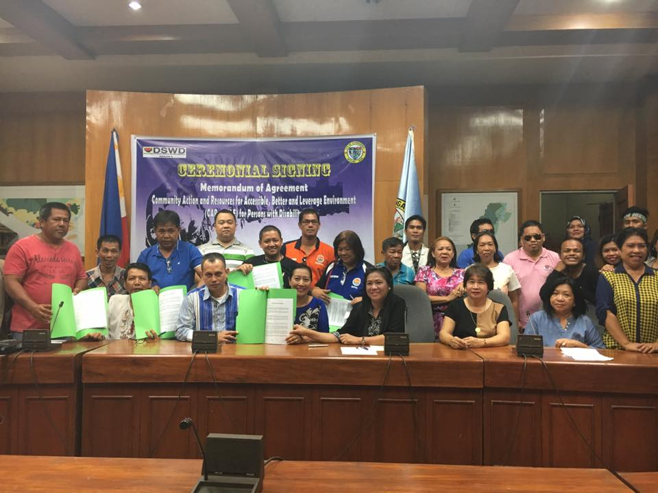 DSWD Officials Asst. Regional Director for Operations Consejo Usman, Social Technology Bureau Representative Marilyn Moral, together with ZC mayor Isabelle Cimaco-Salazar, CSWDO Ma. Socorro Rojas, PWD Official representative Teddy Kahil with some members of PWD community show the signed Memorandum of Agreement on CARe-ABLE project on April 15, 2016 at the Conference Room, City Hall