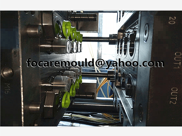 flip top cap injection mold 2k design