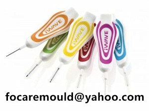 two color brushes between teeth
