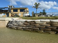 Giant sangbags line the shoreline in the northern New South Wales town of Kingscliff, Tuesday, June 5, 2012. The foreshore which has been progressively eroding has been sandbagged as a last defence to the local Tourist Park and Surf Life Saving Club. (AAP Image/Dave Hunt) NO ARCHIVING