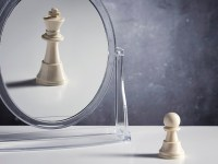 Chess Character king reflection in a mirror