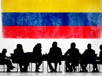 Business People in a Meeting with Colombian Flag