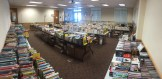 Overflowing book sale tables.