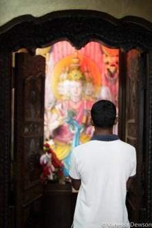 Praying man, Gangaramaya Temple