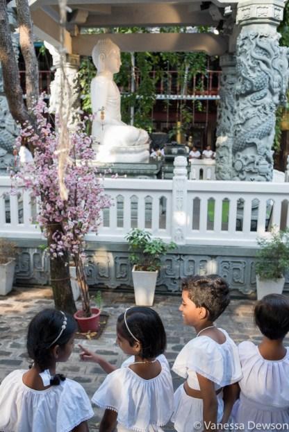 Sunday School children waiting for prayers to begin