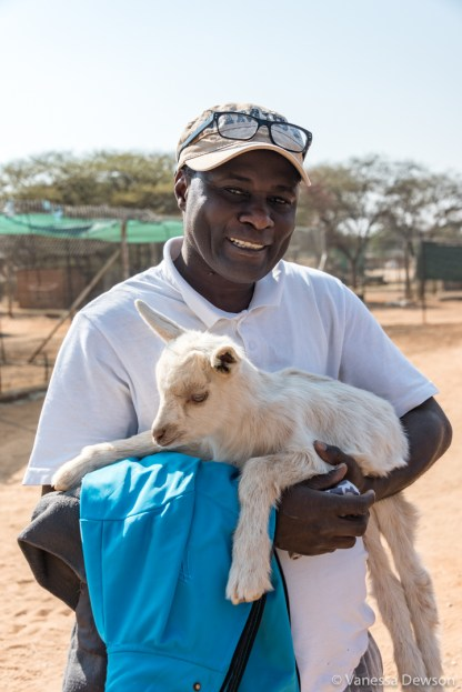 Our driver Elias holding a baby goat.