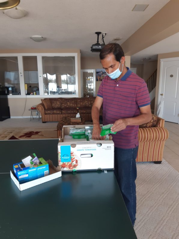 Syed packing Tea bags in Prep for November Diwali & December celebrations