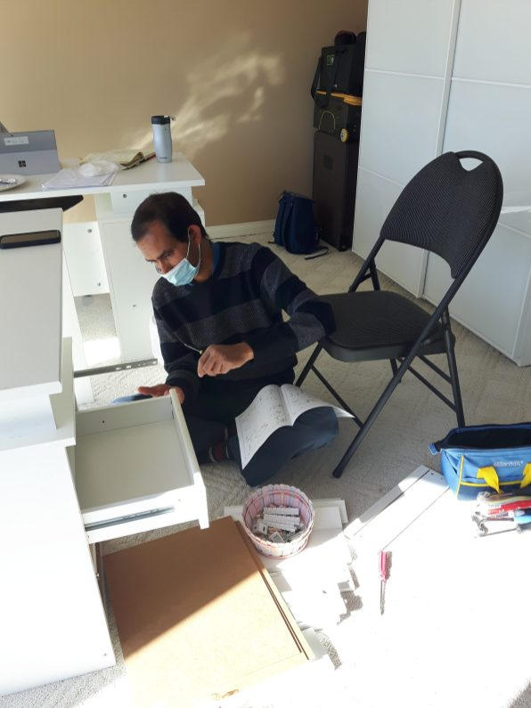 Syed Afzal assembling drawers for office desk