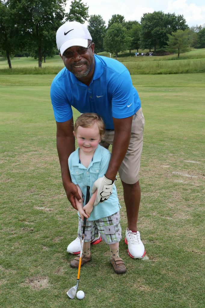 "Darius Rucker helps St. Jude patient Ian Miller perfect his golf swing at the annual ""Darius And Friends"" Golf Tournament on June 3 Photo Credit: Randi Radcliff"