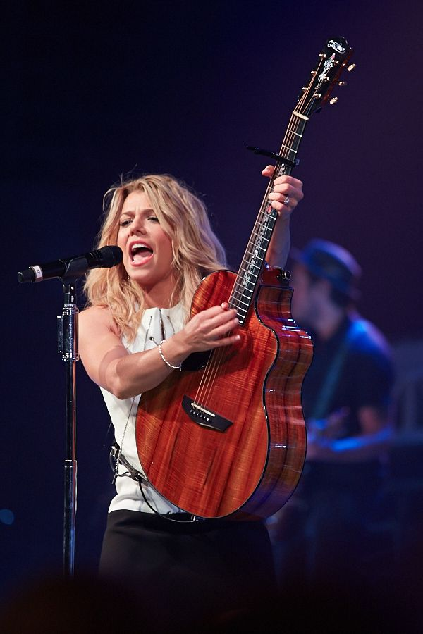 Kimberly Perry from The Band Perry performing during fan club party.
