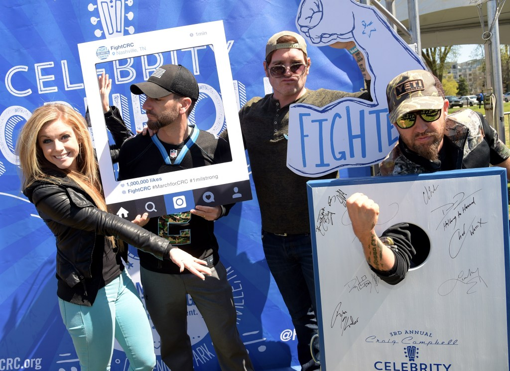 Pictured L-R: Artists Lindsay Ell, Craig Campbell, Jerrod Niemann and LoCash Cowboys member Preston Brust, strike a pose before competing in the 3rd Annual Craig Campbell Celebrity Cornhole Challenge held in Nashville, TN this past Sunday (3/29).  Photo credit: Rick Diamond/Getty Images