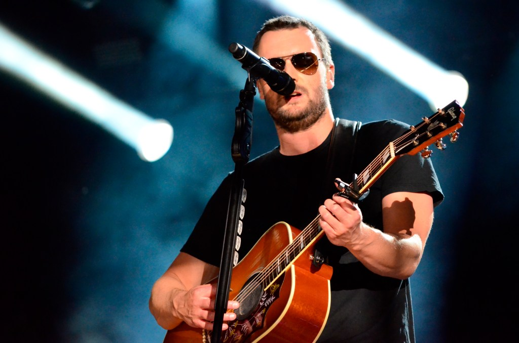 Eric Church performing during night show at LP Stadium during festival.