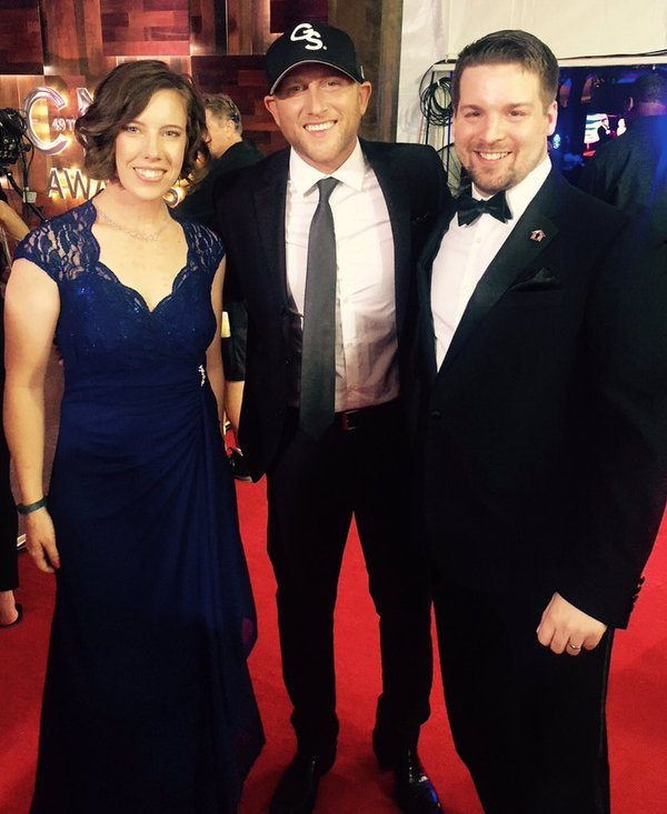 SGT. Joseph James, his wife, Jarin, and Cole Swindell on the CMA Awards Red Carpet.