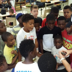 Sebastian entertains the kids by showing them some of his magic tricks!