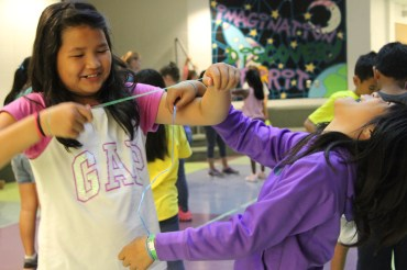 Campers in their drama activity playing tied knot.