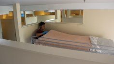 Kevin putting the bed sheets on the mattress
