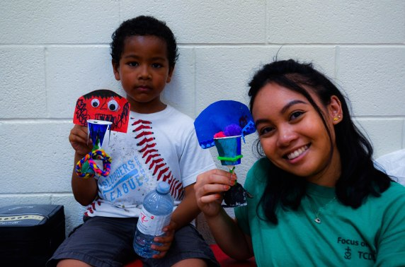 FOY staff Christine and a camper with the mini basketball nets they made during arts and crafts!