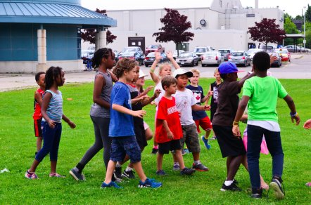 Campers learning how to play rugby.
