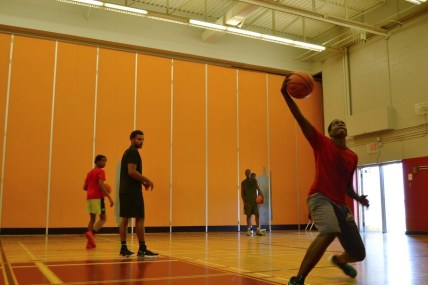 Head coach running a few shooting games to train the campers competitive nature.