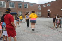 FOY Staff Karina and camper jumping rope