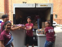 Sebastian, Rachel, Neil, Karen and Aaliyah moving the food out of the truck